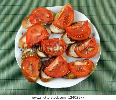 open sandwiches with the fried egg-plants, garlic and tomatoes