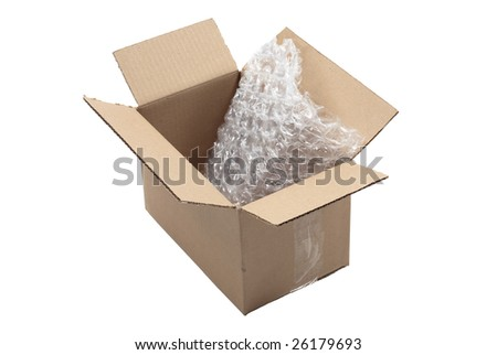Open shipping carton with bubble wrap. Edges are rough as box has been torn open - stock photo
