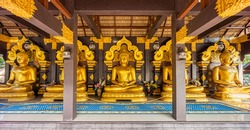 Open-sided wooden pavilion of five Buddha image statues at Wat Phra That Doi Phra Chan. It is Thai Buddhist temple on the top hill of Doi Phra Chan mountain in Mae Tha, Lampang, Thailand.
