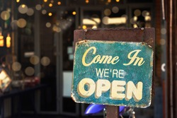 open sign hanging outside a restaurant, store, office or other
