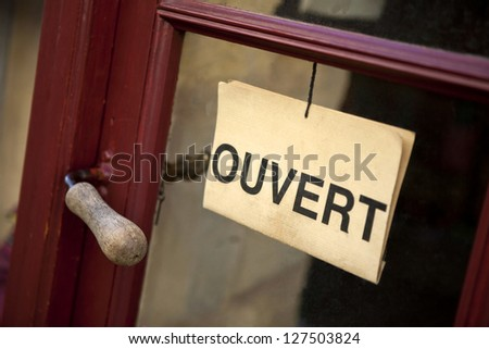 Open sign on the door of a shop - stock photo