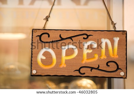 Open sign on the door of country western shop stock photo