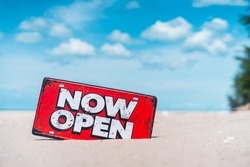 Open sign on tropical sand beach with blue sky background. Summer vacation and travel holiday concept. Vintage tone fitler effect color style.