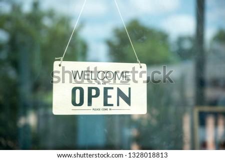 open signboard at the door of restaurant #1328018813