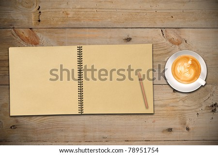Open Sketch Book, Pencil and Latte Art on Wooden Table