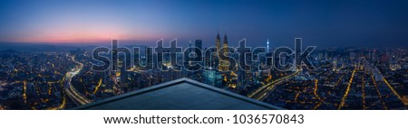 Photo of  Open space balcony with Kuala Lumpur cityscape skyline view  . Night scene .