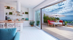 open space kitchen with sliding doors and rooftop patio