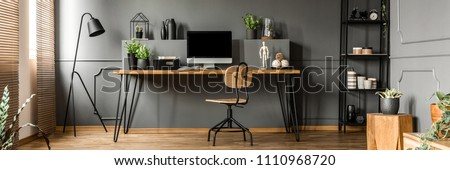 Open space living room interior with mockup computer, fresh plants and decoration placed on a home office desk #1110968720