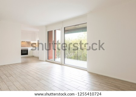 Open space living room with large windows overlooking the nature. Nobody inside #1255410724