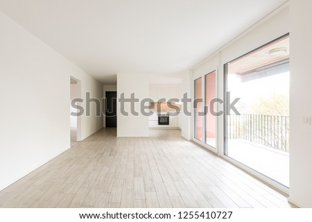 Open space living room with large windows overlooking the nature. Nobody inside #1255410727