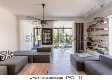Open space of a modern living room overlooking veranda #579734464