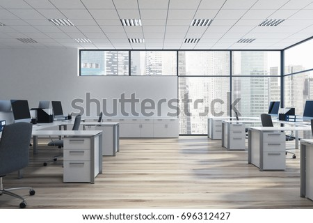 Open space office environment with rows of computer desks and loft windows. 3d rendering mock up