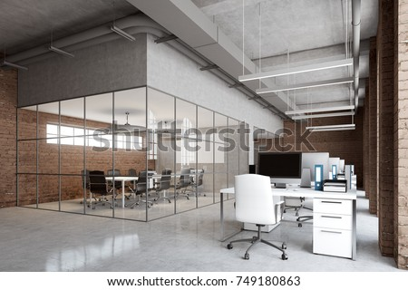 Open space office interior with brick and glass walls, a concrete floor and arch windows. A row of computer desks, desktops with blank screens. 3d rendering mock up