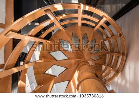 Open staircase, wooden spiral stairs in home interior