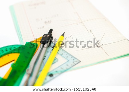 Open student's notebook with the solution of a geometric problem using rulers, compasses and pencil. Trigonometry. Back to school.