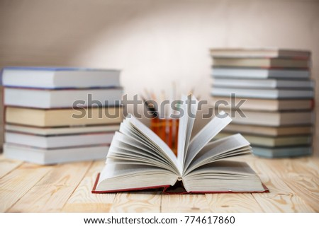 Open textbooks on wood desk with blurred focus for education background. Back to school concept #774617860