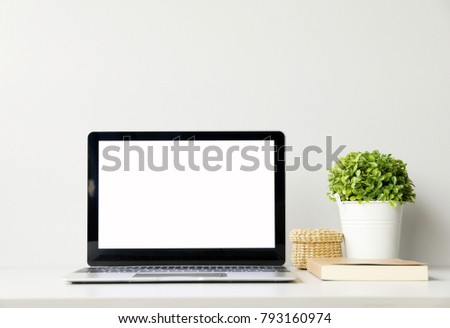 Open the laptop on office desk.front view with copy space.