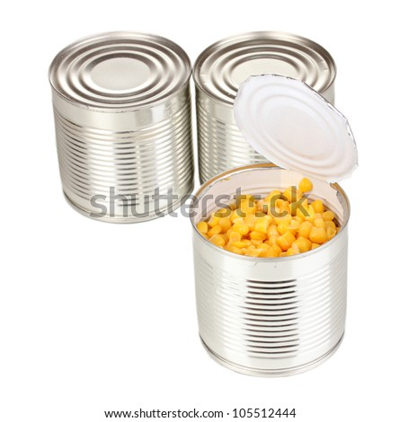 Open tin can of corn and closed cans isolated on white