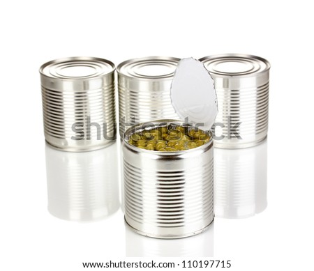 Open tin can of peas and closed cans isolated on white