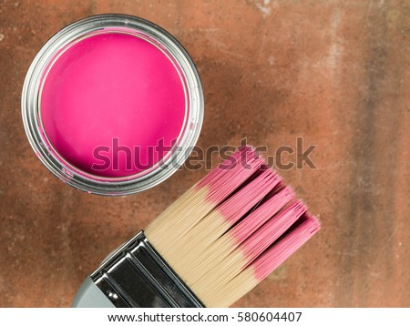 Open Tin of Pink Paint and a Paint Brush #580604407