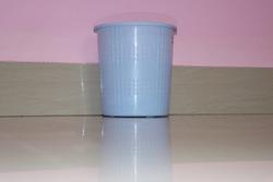 Open trash can or empty dust bin in the room