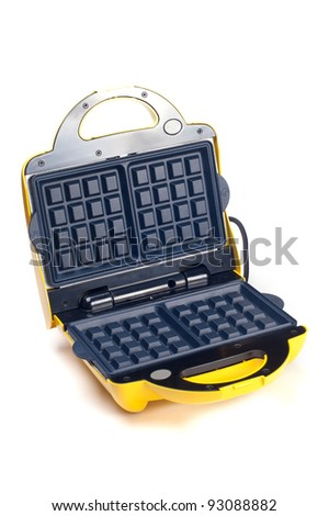 Open waffle iron on a white background