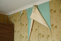 Open wallpaper seam on damp walls, peeling wallpaper seam repair