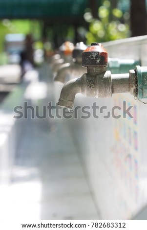 Open water from cork. Water flows from the faucet. School faucet. Droplet from the faucet. #782683312