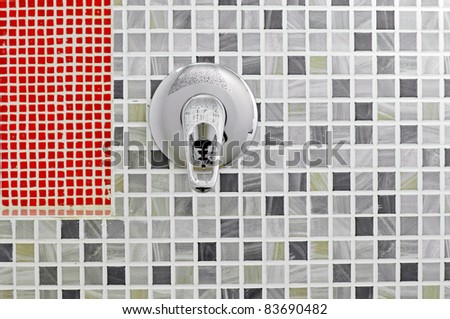 Open water in the bathroom with mosaic tiles in the background