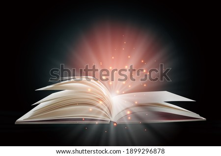 Open white paper fantasy book with shining pages isolated on black background. Miracle concept and mystery idea Foto stock ©