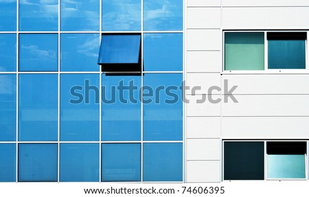 Open window in modern glass wall office building - stock photo