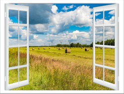 open window overlooking field with hay after harvesting countryside