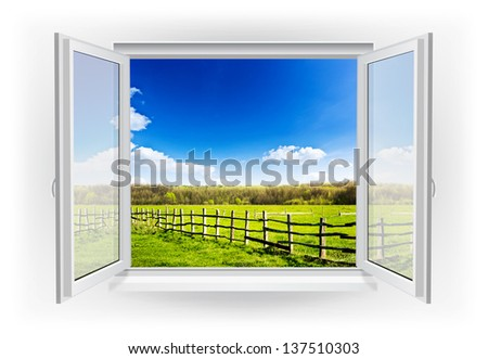 Open window with green field with fence under blue sky on a background