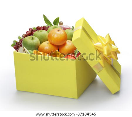 open yellow gift box, packing fruit - stock photo