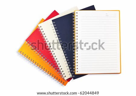 open yellow note book place on stack of note book