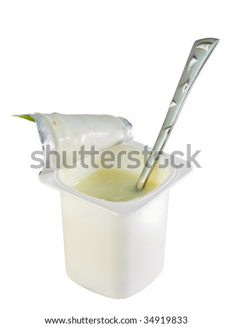 open yogurt with a tea spoon isolated on white