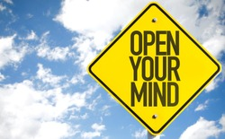 Open Your Mind sign with sky background
