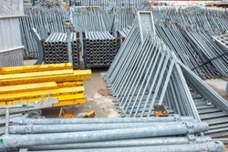 Openair storage of galvanized steel and aluminum frames, ladders, and ringlock scaffolding systems for many applications on restoration, industrial and construction sites.