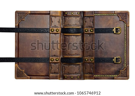 Opened aged brown leather cover with gilded frame and embossed leather stripes in high resolution - Shutterstock ID 1065746912