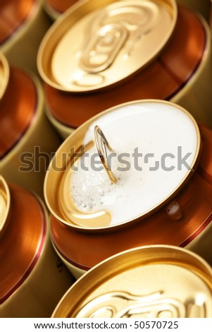 Opened beer can with froth. Shallow DOF!