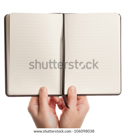Opened book in hands isolated on white background