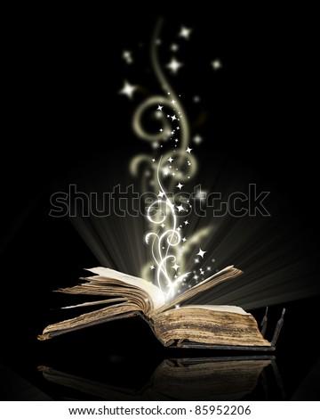 Opened book magic on black