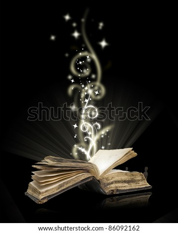 Opened book magic on black - stock photo