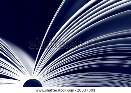 Opened book on black background -  colored blue - stock photo
