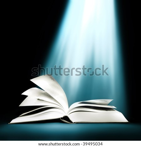 Opened book with bright light beam