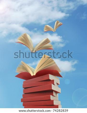 opened books flying away