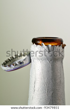 opened bottle beer in isolated background