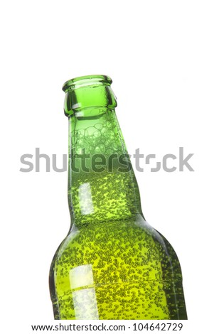 opened bottle of beer with foam and bubbles - stock photo