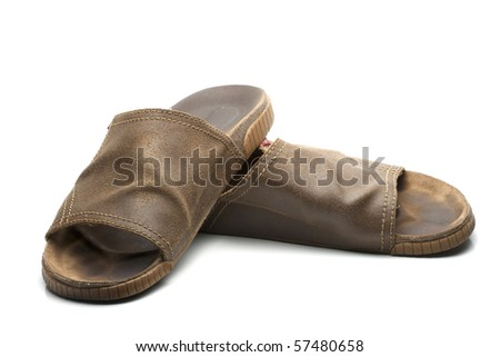 opened brown leather slippers