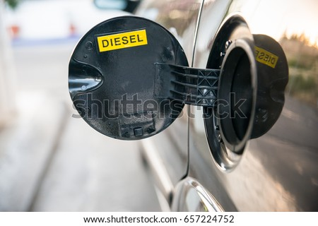 Opened car fuel tank with the word diesel. Copy space for text